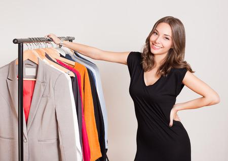 brunette: Portrait of a gorgeous young brunette woman shopping clothes.