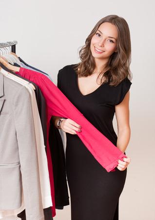 woman clothes: Portrait of a gorgeous young brunette woman shopping clothes.