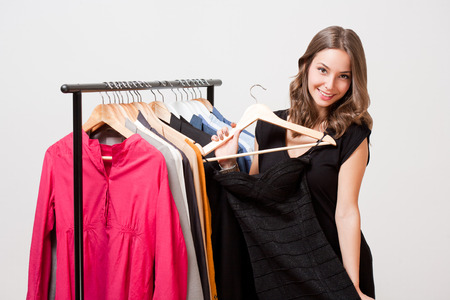 selection: Portrait of a gorgeous young brunette woman shopping clothes.