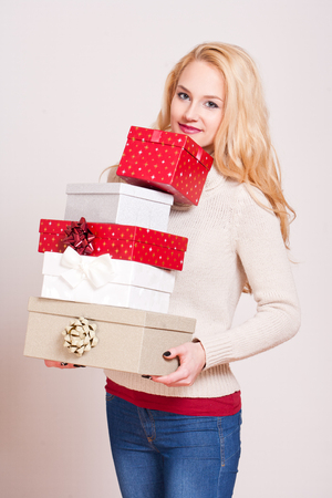 gorgeous woman: Portrait of a gorgeous young blond woman with Christmas gift boxes.