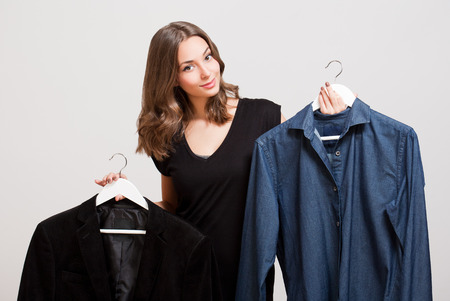 choosing: Portrait of a gorgeous young brunette woman shopping clothes.