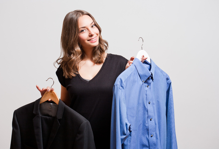 woman clothes: Portrait of a young brunette beauty having shopping fun. Stock Photo