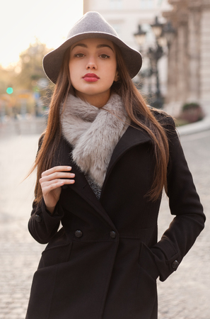 winter fashion: Portrait of a young brunette woman wearing elegant winter fashion. Stock Photo
