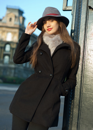 winter fashion: Winter fashion street portrait of a gorgeous young brunette woman.