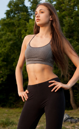 asian abs: Portrait of a fit fit young brunette woman outdoors. Stock Photo