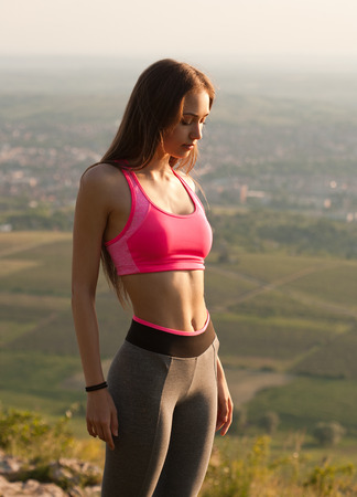 yoga pants: Beautiful young slender woman relaxing outdoors in nature.