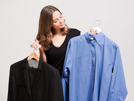 choosing clothes: Portrait of a young brunette beauty having shopping fun. Stock Photo