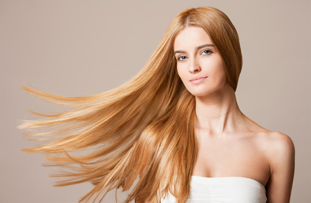 hair background: Portrait of a blond beauty with beautiful healthy long hair.