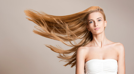 Portrait of a beautiful young blond woman with amazing flowing hair. Фото со стока - 52411007