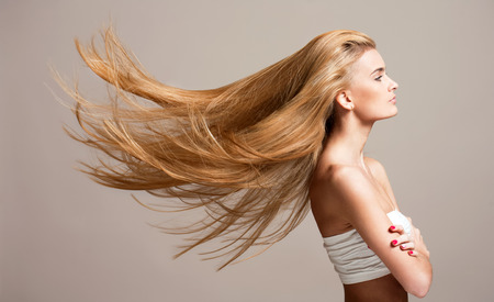 grey hair female: Portrait of a beautiful young blond woman with amazing flowing hair.