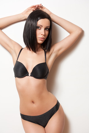 sexy black woman: Portrait of a young slender sensual brunette woman in lingerie. Stock Photo