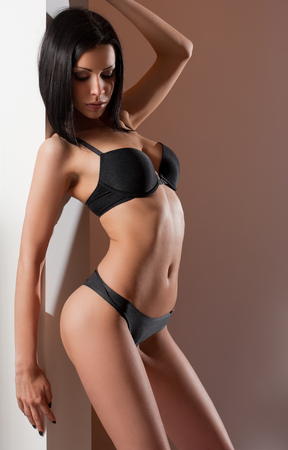 black bra: Portrait of a sexy young brunette woman wearing lingerie. Stock Photo