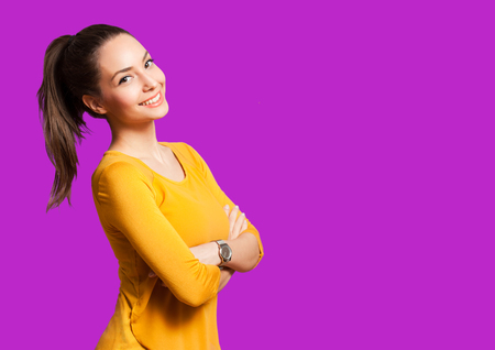 confident woman: Portrait of an expressive brunette isolated on colorful background.