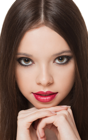 beautiful teen girl: Portrait of a young charming brunette makeup beauty. Stock Photo