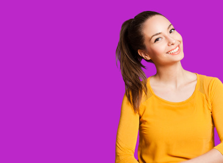 yellow teeth: Portrait of an expressive brunette isolated on colorful background.