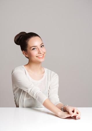 Portrait of a beautiful charming happy brunette woman.
