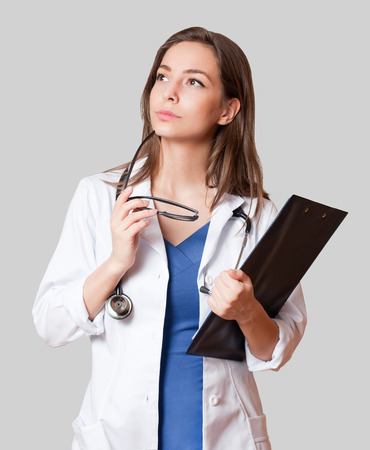 Portrait of a beautiful young woman doctor with stethoscope.