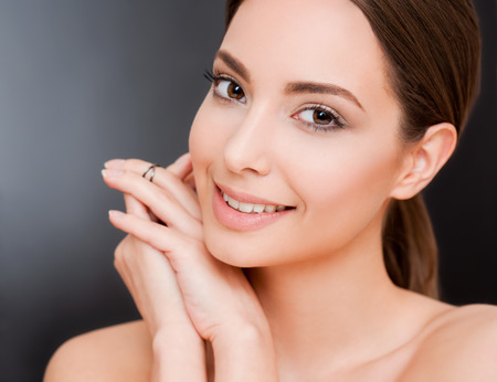 Portrait of a happy smiling brunette makeup beauty. Stock Photo