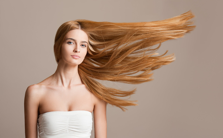 Portrait of a beautiful young blond woman with amazing flowing hair.
