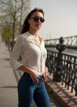 happy asian people: Portrait of a fashionable stylish brunette beauty outdoors. Stock Photo