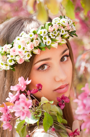 pink flowers: Portrait of a gorgeous spring woman outdoors in nature.