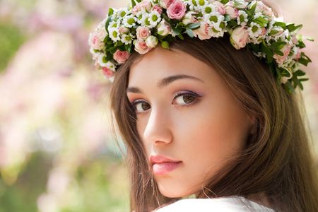 scents: Portrait of a gorgeous spring woman outdoors in nature.