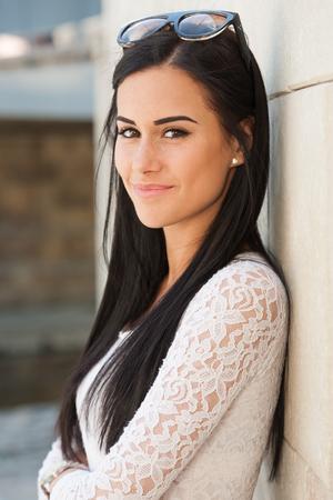 Portrait of stylish brunette fashionable summer beauty outdoors. photo
