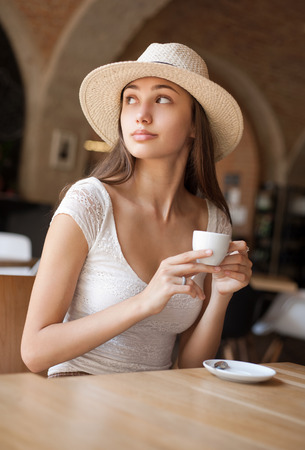 straws: Portrait of a gorgeous young brunette woman with espresso.
