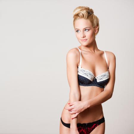 nude blonde woman: Portrait of a beautiful slender blond lingerie model.