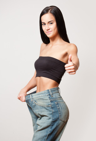 Portrait of a slim young brunette woman with fit body.