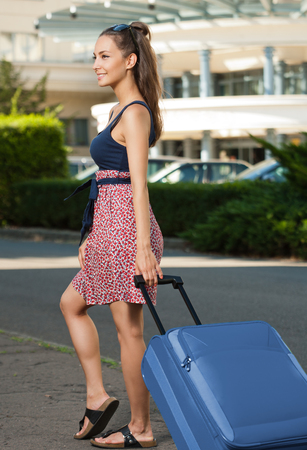 young beautiful woman: Portrait of beautiful young traveler woman with suitcase.
