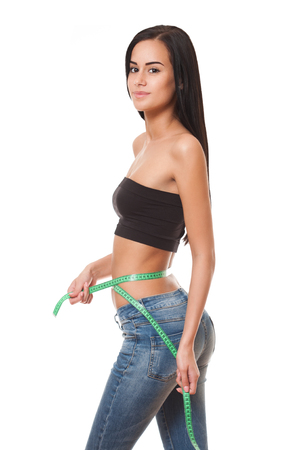 Portrait of a fit young brunette woman showing off her slender figure.