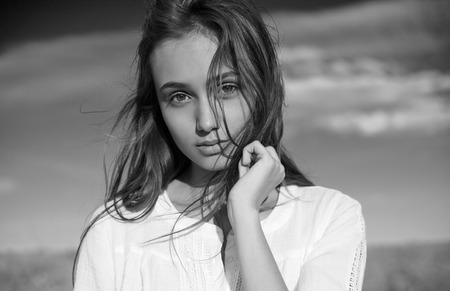 Sensual emotional black and white portrait of a gorgeous young brunette woman.