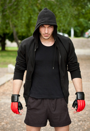 Handsome young athlete man doing urban street workout. Stock Photo