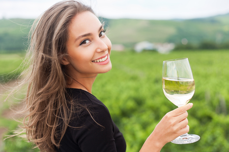 travel woman: Portrait of a gorgeous young brunette woman having wine fun.