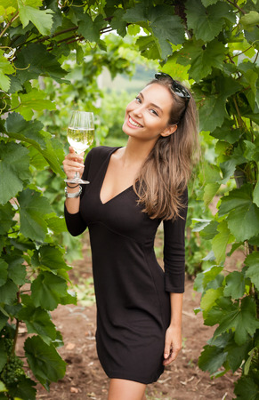 chardonnay: Outdoors portrait of a beautiful wine tasting tourist woman.