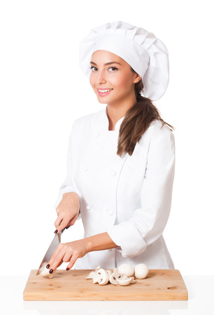 Portrait of a beautiful young brunette chef woman.
