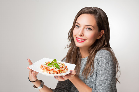 Gorgeous young brunette woman having Italian food. Stock Photo
