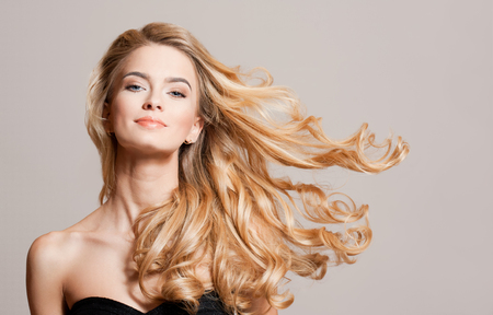 strong wind: Portrait of blond beauty with amazing long healthy hair.