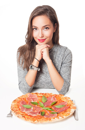 woman eat: Beautiful young brunette woman eating Italian meal. Stock Photo