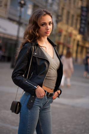 Gorgeous fashionable sexy young brunette woman street portraits. Stock Photo