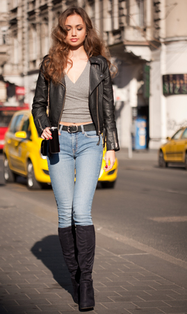 Street portrait of beautiful young fashionable brunette woman. Stock Photo