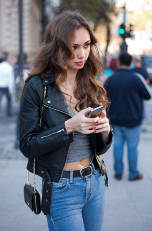 Gorgeous fashionable sexy young brunette woman street portraits. 스톡 콘텐츠