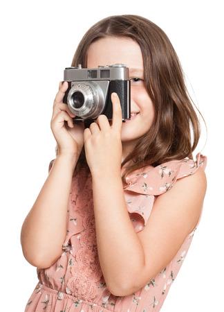 Portrait of a cute brunette girl using vintage camera.