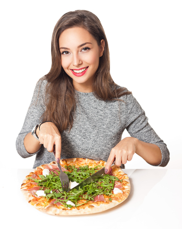 Beautiful young brunette woman eating Italian pizza. photo