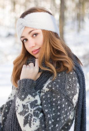 Outdoors portrait of a brunette winter fashion beauty.