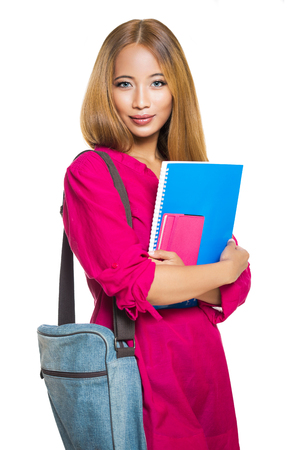 Portrait of a gorgeous young asian student woman isolated on white background. Stock Photo