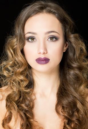 Portrait of a young brunette cosmetics beauty. Imagens