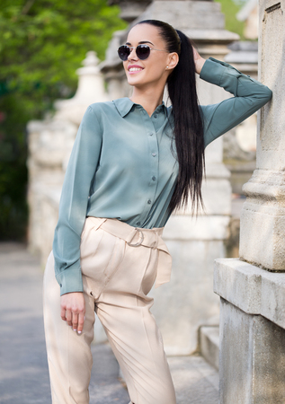 Outdoors portait of stylish young fashion  brunette.
