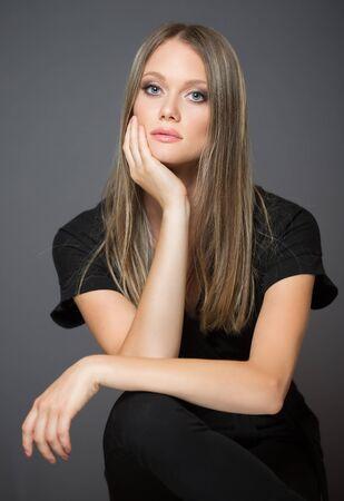 Portrait of a blond cosmetics beauty in light makeup.